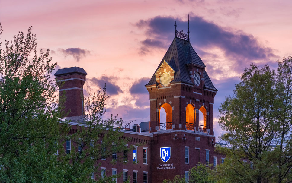 UNH Manchester campus at sunset