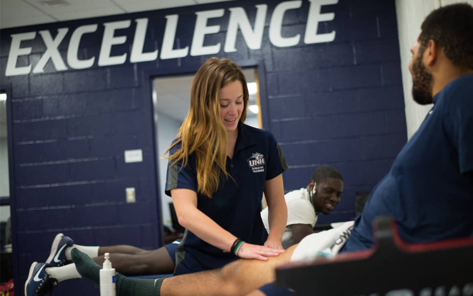 Athletic Training students work student athletes in the UNH Field house