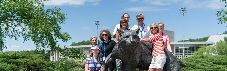 Image of Alumni near Wildcat Statue