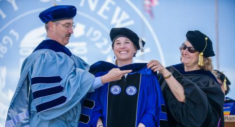 Image of doctoral student getting hooded